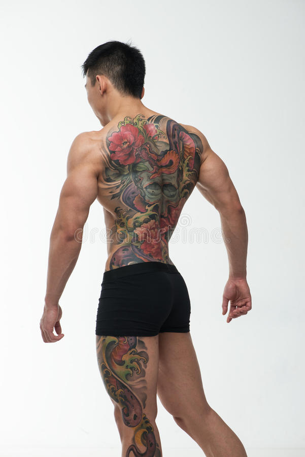 Asiatisk modell med tatueringen royaltyfria bilder