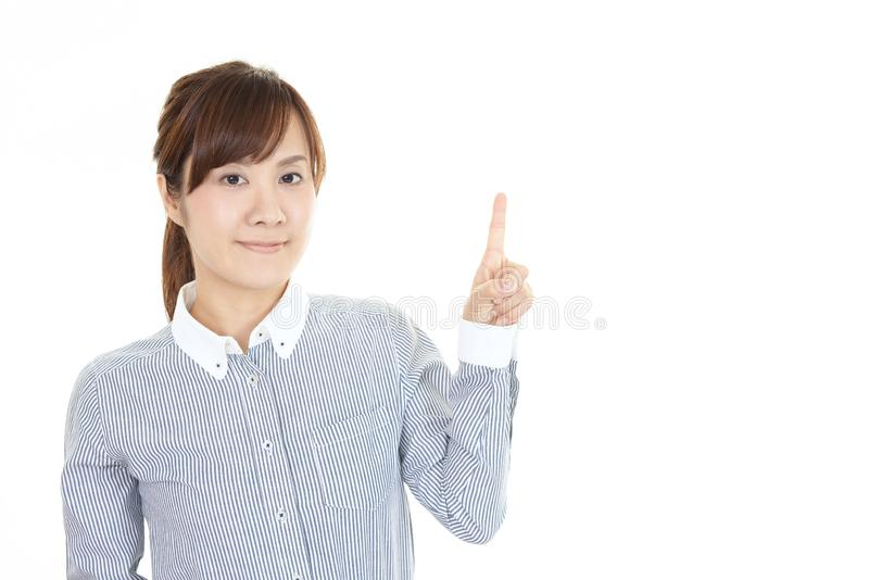 asiatisk pekande kvinna royaltyfri bild