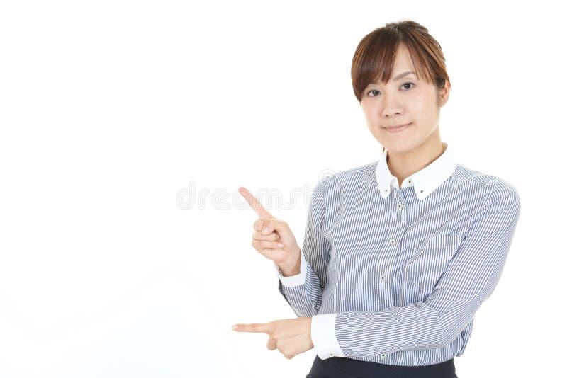asiatisk pekande kvinna arkivfoto