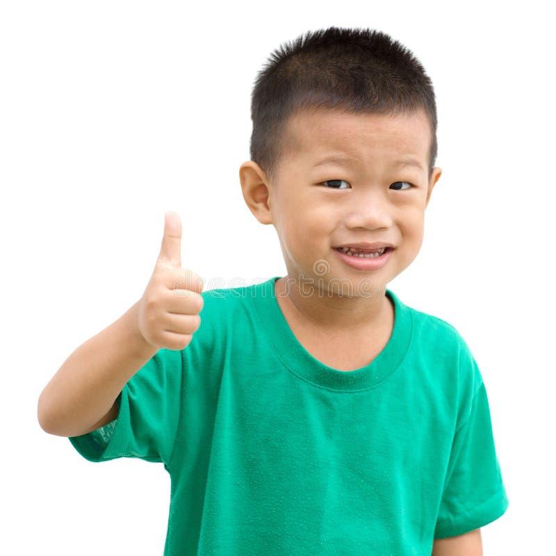 Asiatisk pojketumme upp arkivfoton