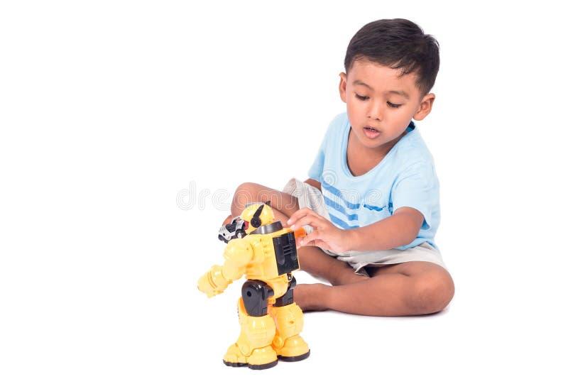 Asiatisk pyslek och upphetsad robotstridighetleksak royaltyfria foton
