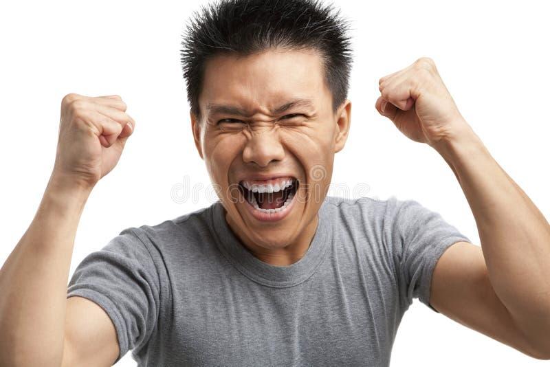 asiatisk spänning som uttrycker hans man arkivfoto