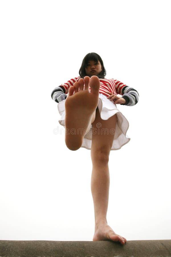 asiatisk standing för flickaben ett royaltyfria foton