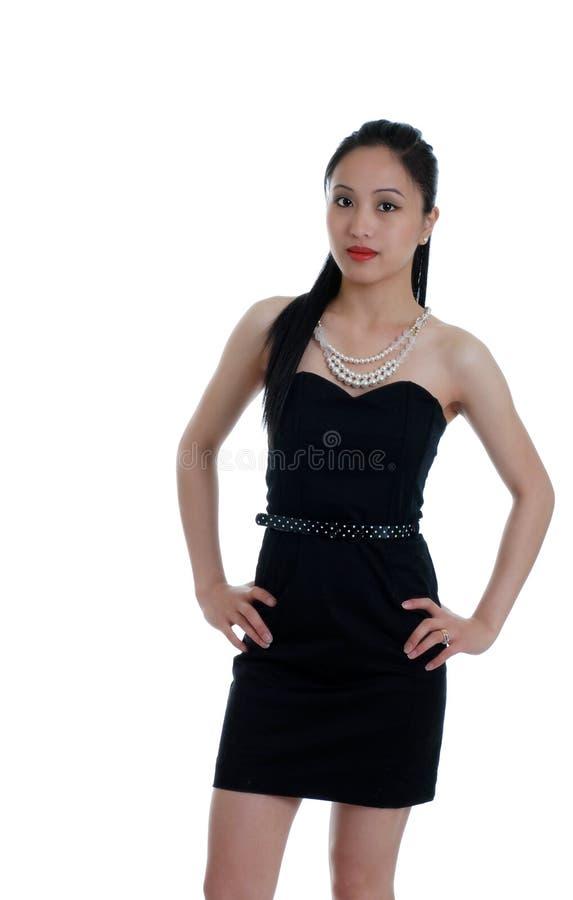 asiatisk svart klänning isolerad frugan fotografering för bildbyråer