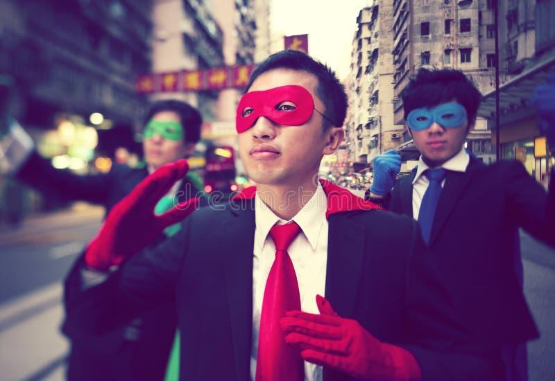 Asiatiska affärsmanSuperheroes royaltyfria bilder