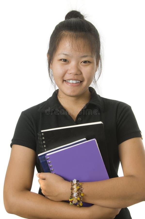 asiatiska böcker henne standingwithdeltagare royaltyfri fotografi