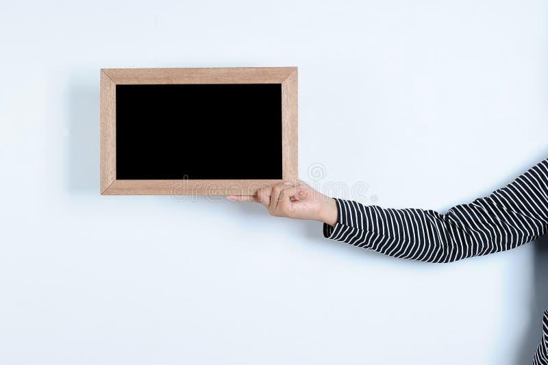 Asiatiska kvinnah?nder som rymmer svart tavla arkivbild