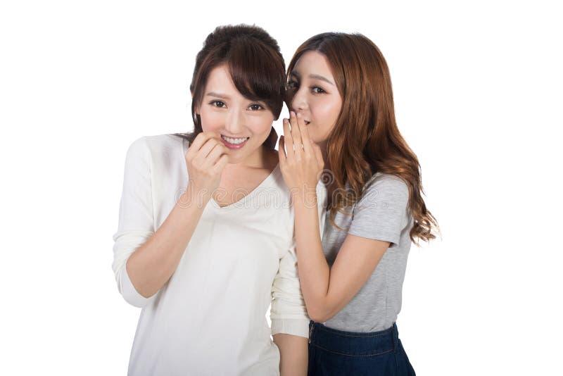 Asiatiska vänners viskning arkivfoton