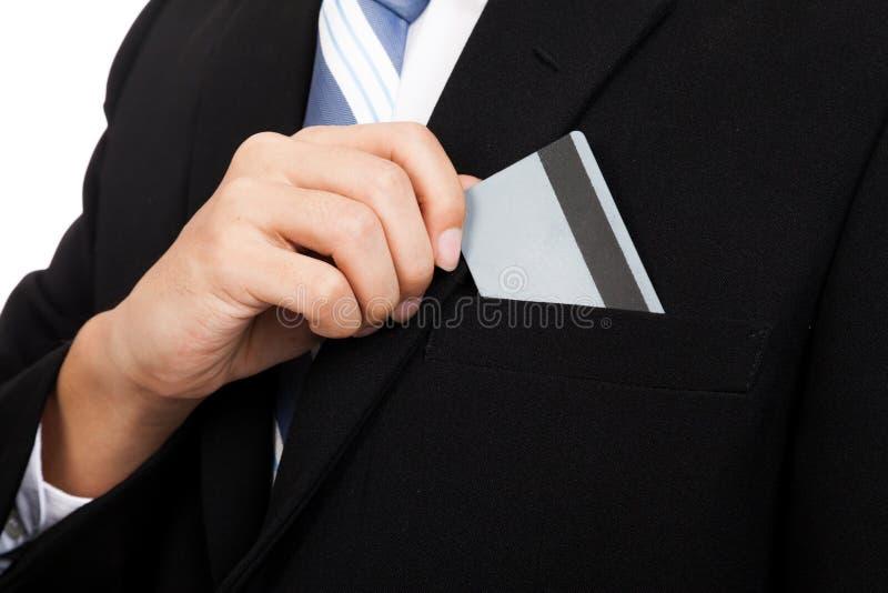 Asiatiskt affärsmanhandtag ett kort från hans fack arkivfoton