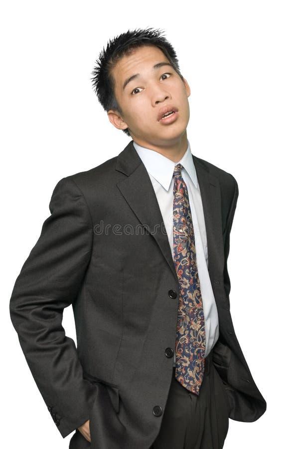 asiatiskt affärsmanståendebarn arkivfoton