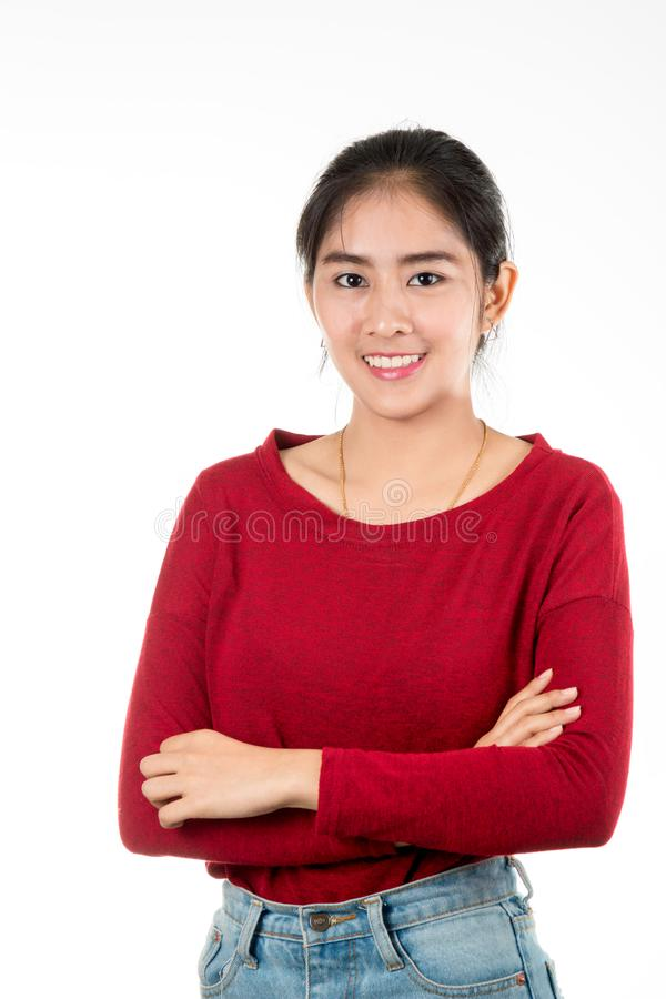 Asiatiskt kvinnaanseende, genom att korsa hennes arm på vit bakgrund royaltyfria bilder