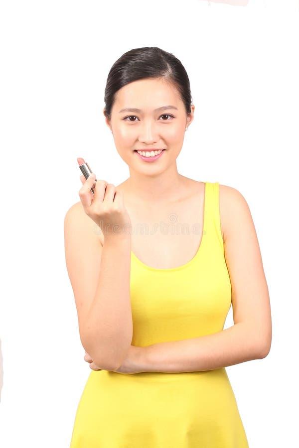 Asiatiskt kvinnligt posera med läppstift - serie 2 royaltyfri foto