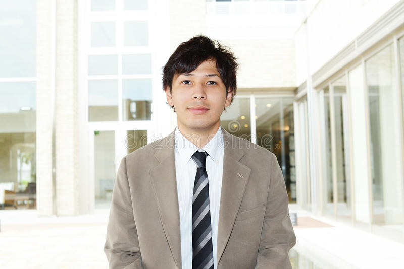 asiatiskt le för affärsman royaltyfri fotografi