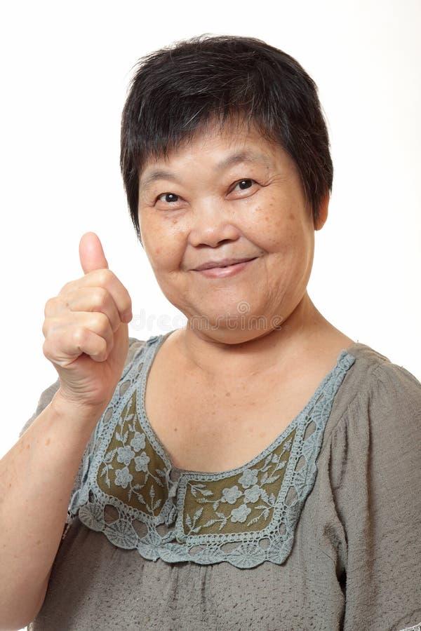 asiatiskt lyckligt kvinnabarn royaltyfri fotografi
