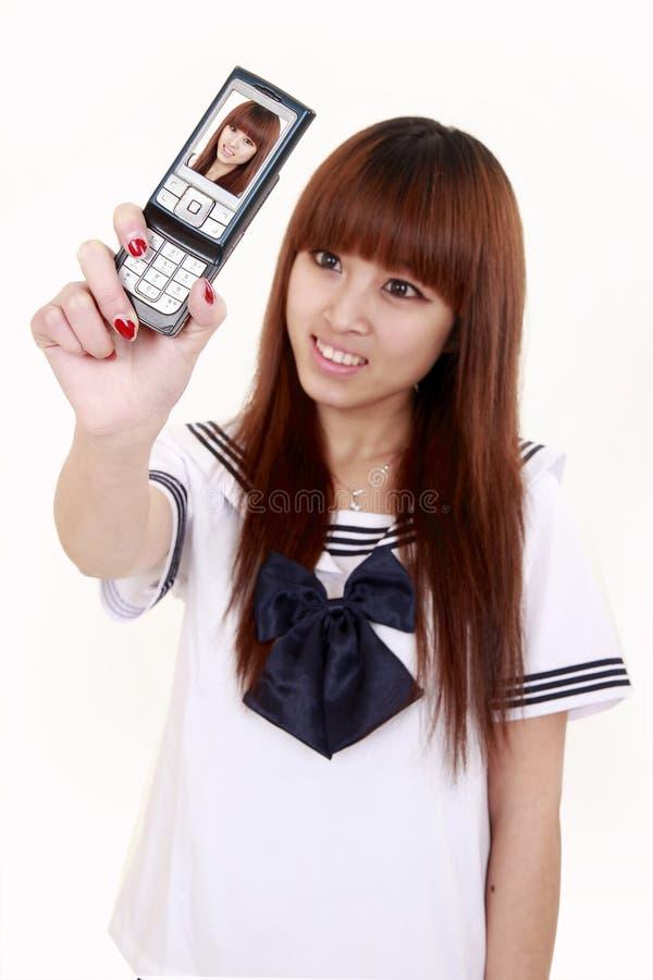 Asien-Mädchenselbstschuß stockfoto