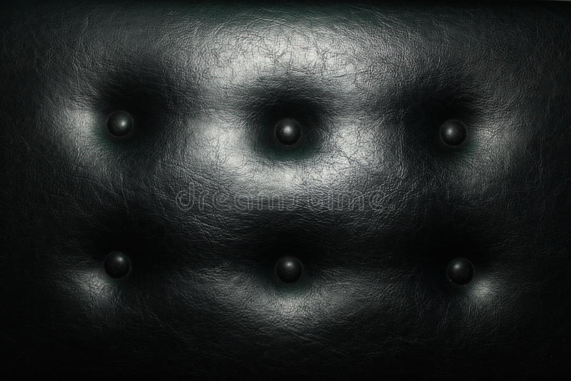 Asiente la suavidad de cuero con los botones del cuero negro imagen de archivo