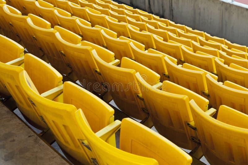 Asiento anaranjado vacío del estadio imagen de archivo libre de regalías