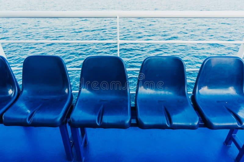 Asientos azules en un transbordador imágenes de archivo libres de regalías