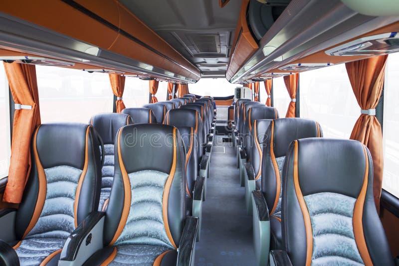 Asientos del autobús del turismo fotos de archivo