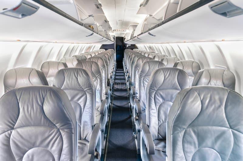 Asientos genéricos del aeroplano en aeroplano moderno fotografía de archivo libre de regalías