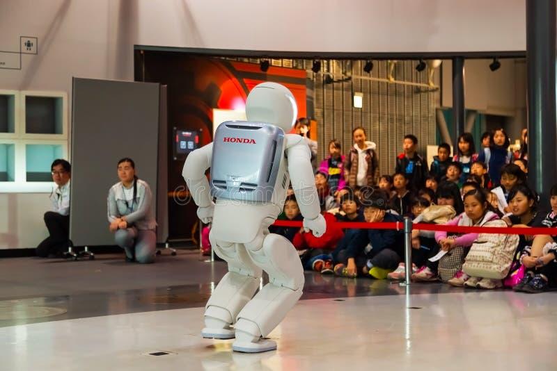 Asimo the humanoid robot. TOKYO, JAPAN - NOVEMBER 27 2015: Asimo, the humanoid robot created by Honda is presented at Miraikan, The National Museum of Emerging royalty free stock photos
