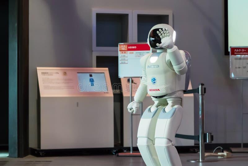 Asimo the humanoid robot. TOKYO, JAPAN - NOVEMBER 27 2015: Asimo, the humanoid robot created by Honda is presented at Miraikan, The National Museum of Emerging royalty free stock photography