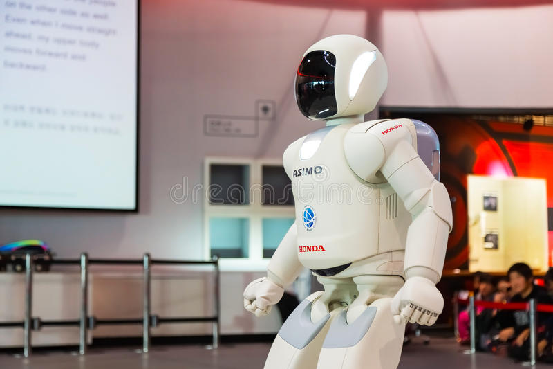 Asimo, the humanoid robot. TOKYO, JAPAN - NOVEMBER 27 2015: Asimo, the humanoid robot created by Honda is presented at Miraikan, The National Museum of Emerging stock photo