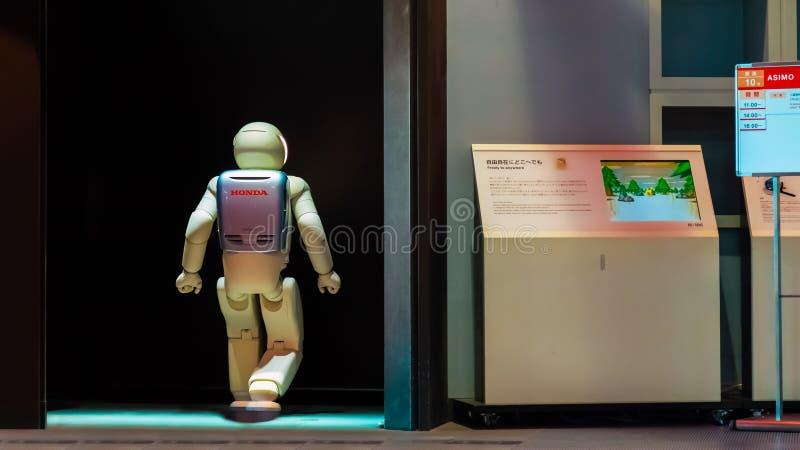 Asimo, the humanoid robot. TOKYO, JAPAN - NOVEMBER 27 2015: Asimo, the humanoid robot created by Honda is presented at Miraikan, The National Museum of Emerging stock images