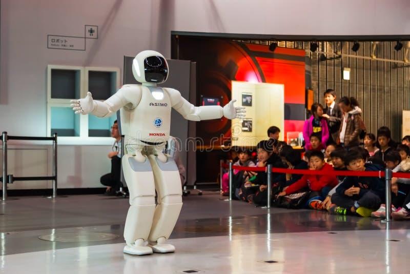 Asimo, the humanoid robot. TOKYO, JAPAN - NOVEMBER 27 2015: Asimo, the humanoid robot created by Honda is presented at Miraikan, The National Museum of Emerging royalty free stock photo