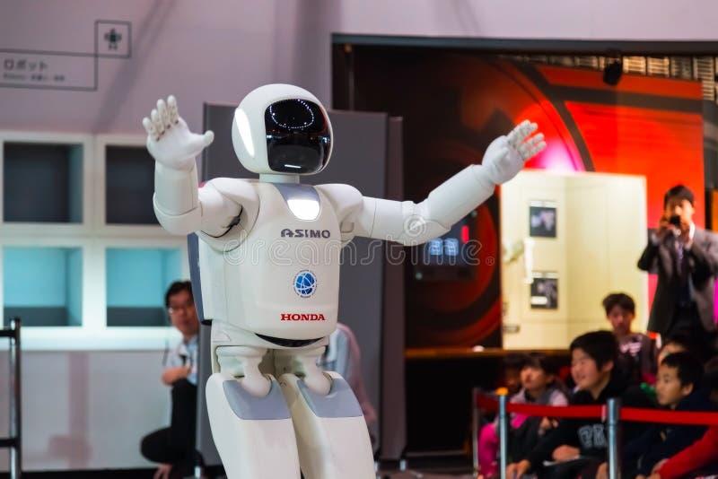 Asimo, the humanoid robot. TOKYO, JAPAN - NOVEMBER 27 2015: Asimo, the humanoid robot created by Honda is presented at Miraikan, The National Museum of Emerging royalty free stock photography
