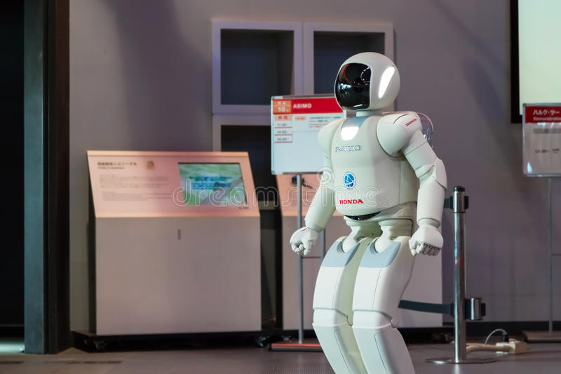 Asimo, the humanoid robot. TOKYO, JAPAN - NOVEMBER 27 2015: Asimo, the humanoid robot created by Honda is presented at Miraikan, The National Museum of Emerging stock photos
