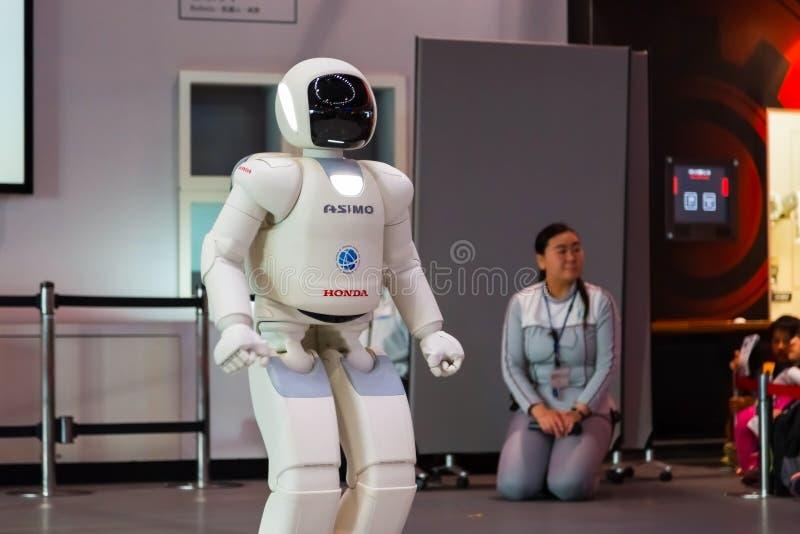 Asimo the humanoid robot. TOKYO, JAPAN - NOVEMBER 27 2015: Asimo, the humanoid robot created by Honda is presented at Miraikan, The National Museum of Emerging stock photo