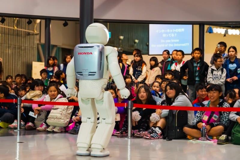 Asimo the humanoid robot. TOKYO, JAPAN - NOVEMBER 27 2015: Asimo, the humanoid robot created by Honda is presented at Miraikan, The National Museum of Emerging stock images
