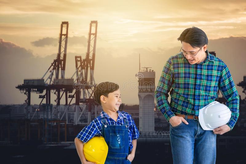 Father and son walking together in Transportation port industry for family industry future concept royalty free stock photography