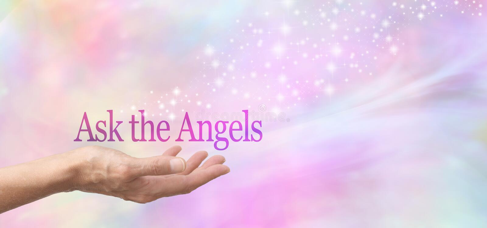 Ask the Angels for Help. Female hand face up with the words Ask the Angels floating above on a misty pastel bokeh background and a stream of sparkles flowing