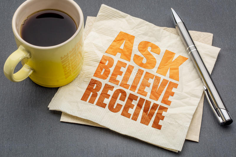 Ask, believe, receive concept on napkin. Ask, believe, receive - spiritual words on a napkin with cup of coffee royalty free stock photos
