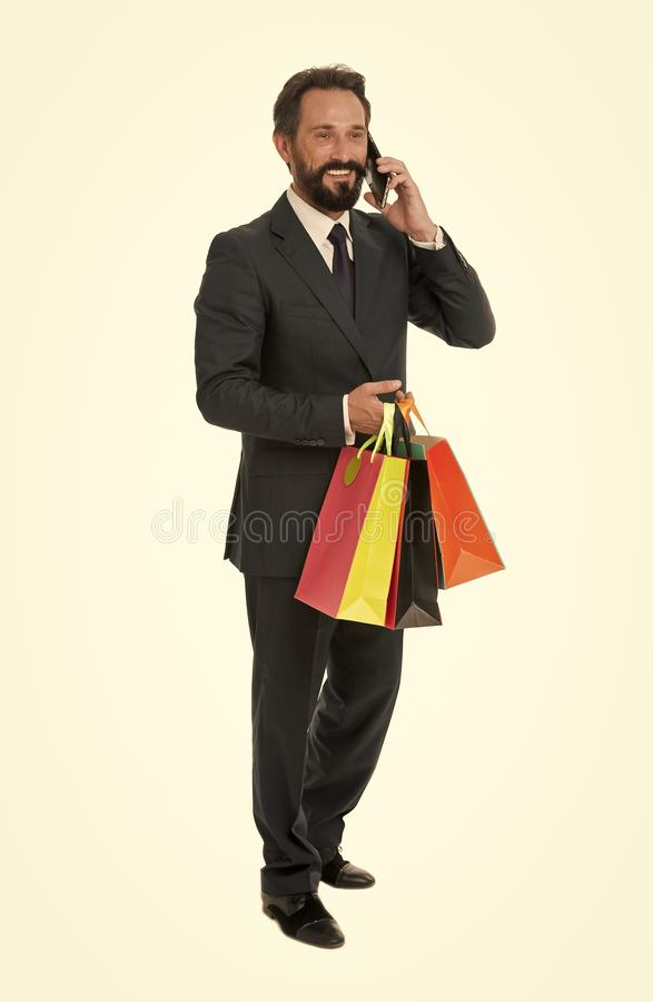 Ask deliver your purchases. Business communications. Busy with conversation. Businessman formal suit holds bunch paper. Bags while call smartphone. Man bearded stock photo