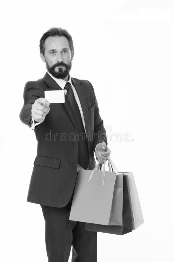Ask deliver your purchases. Businessman formal suit holds bunch paper bags while show business card. Man bearded royalty free stock photos