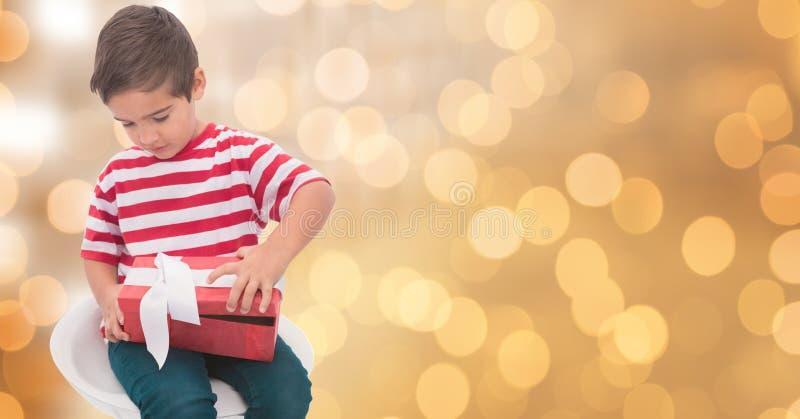 Ask för pysöppningsgåva över bokeh royaltyfria bilder