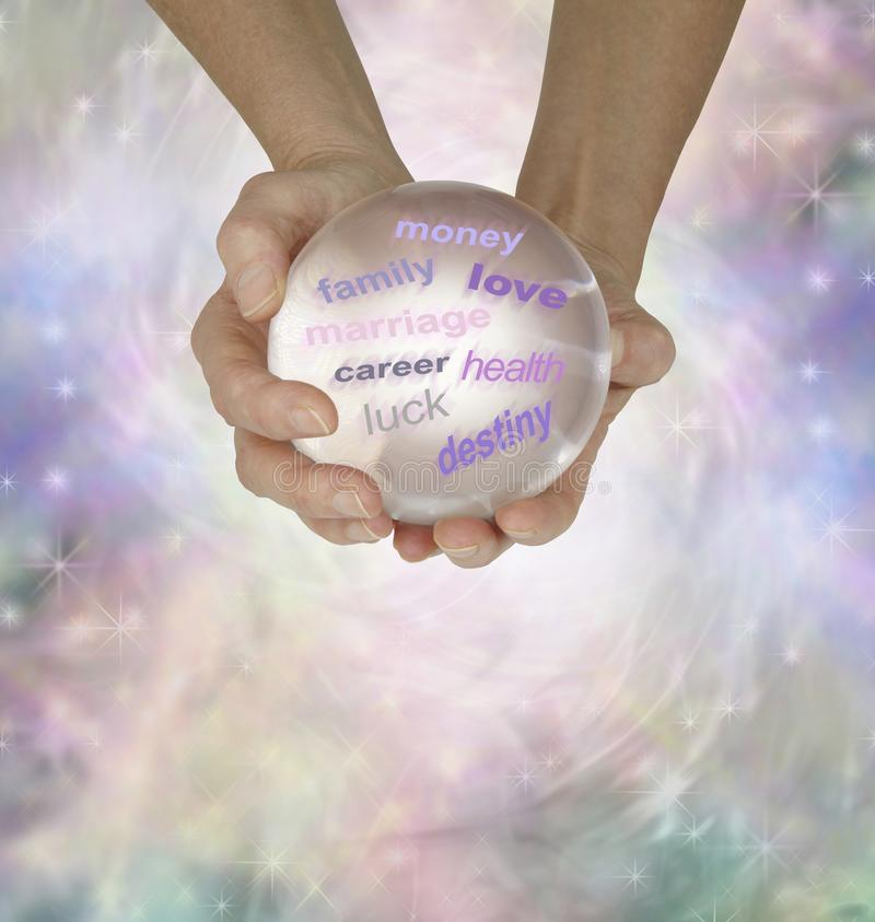 Ask me a question about your future. Female hands holding a large clear crystal ball showing various words on a light sparkly ethereal energy formation stock photos