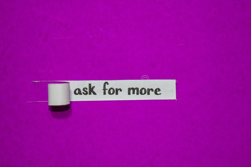 Ask for more, Inspiration, Motivation and business concept on purple torn paper stock photography