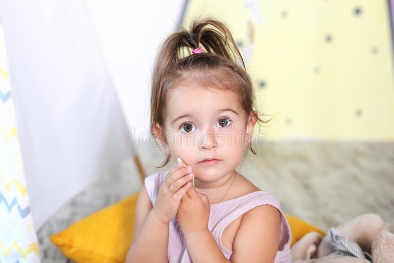 Ask permission. Prohibited behavior. Little girl is sad to ask permission. Please concept. Let me please. Baby cute face close-up. Astonished child with open royalty free stock images