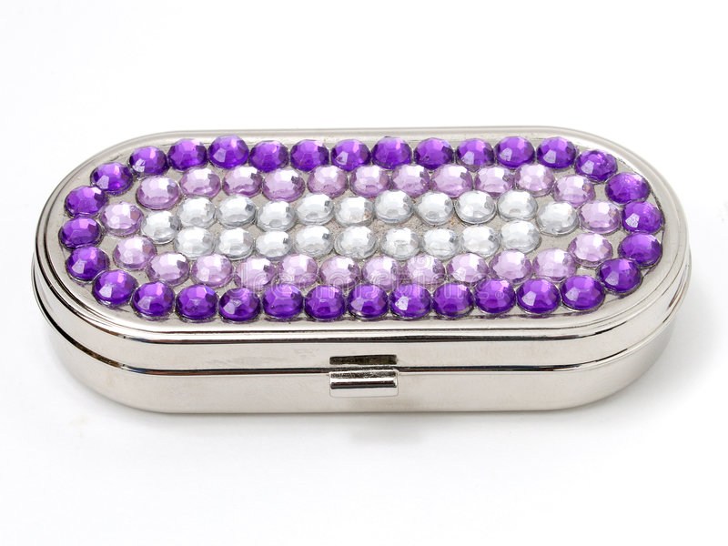 ask prydd med ädelsten pill royaltyfria foton