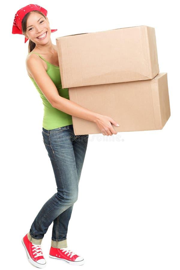 askar som bär den moving kvinnan arkivbild