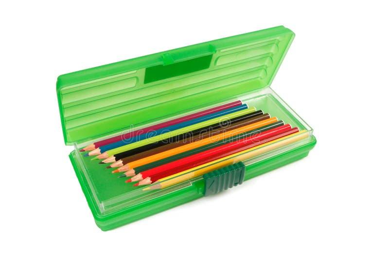 asken crayons blyertspennabrevpapper royaltyfria bilder