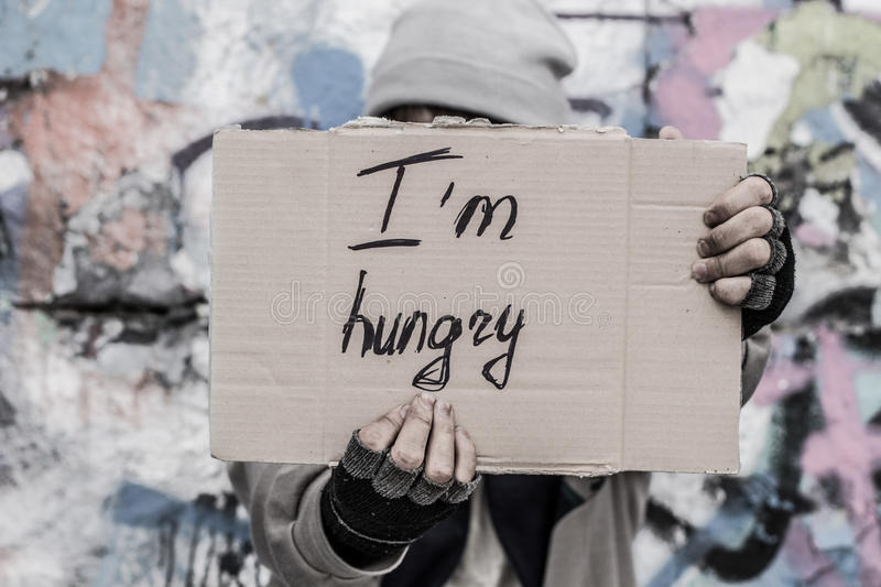 Asking for food. Homeless man holding sign asking for food royalty free stock photos