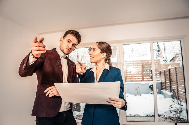 Handsome businessman asking questions to professional realtor stock photos