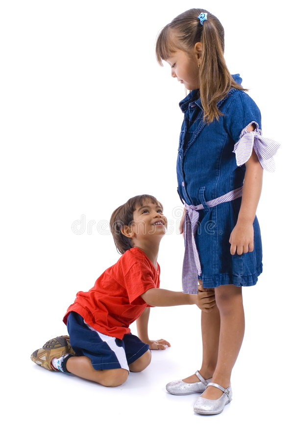 Asking Sorry. Happy boy asking sorry for the girl royalty free stock photography