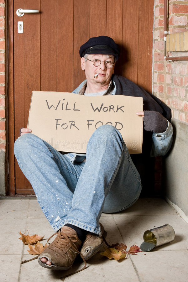 Asking for work. Unemployed beggar in the streets asking for a job royalty free stock image