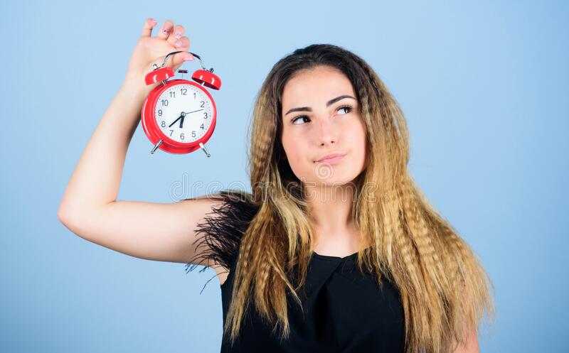 Asleep and awake. time management. time zone. punctuality and discipline. girl hold alarm clock. regime early awakening stock images